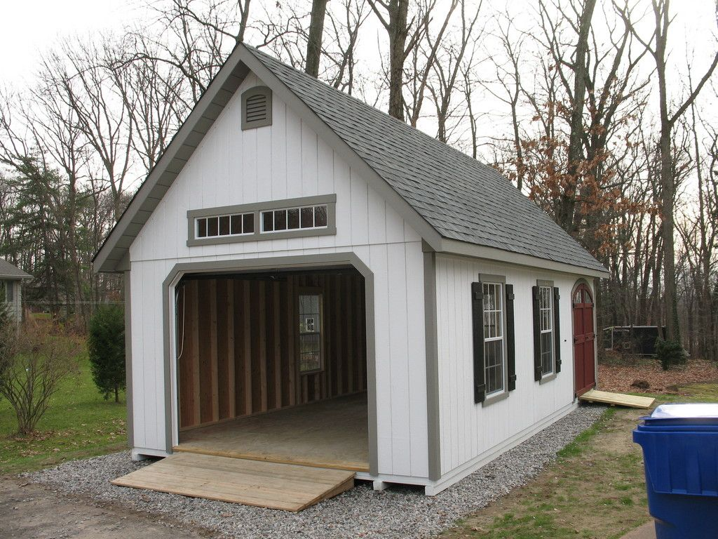 Garden shed garage door on one end home pinterest for Shed with garage door