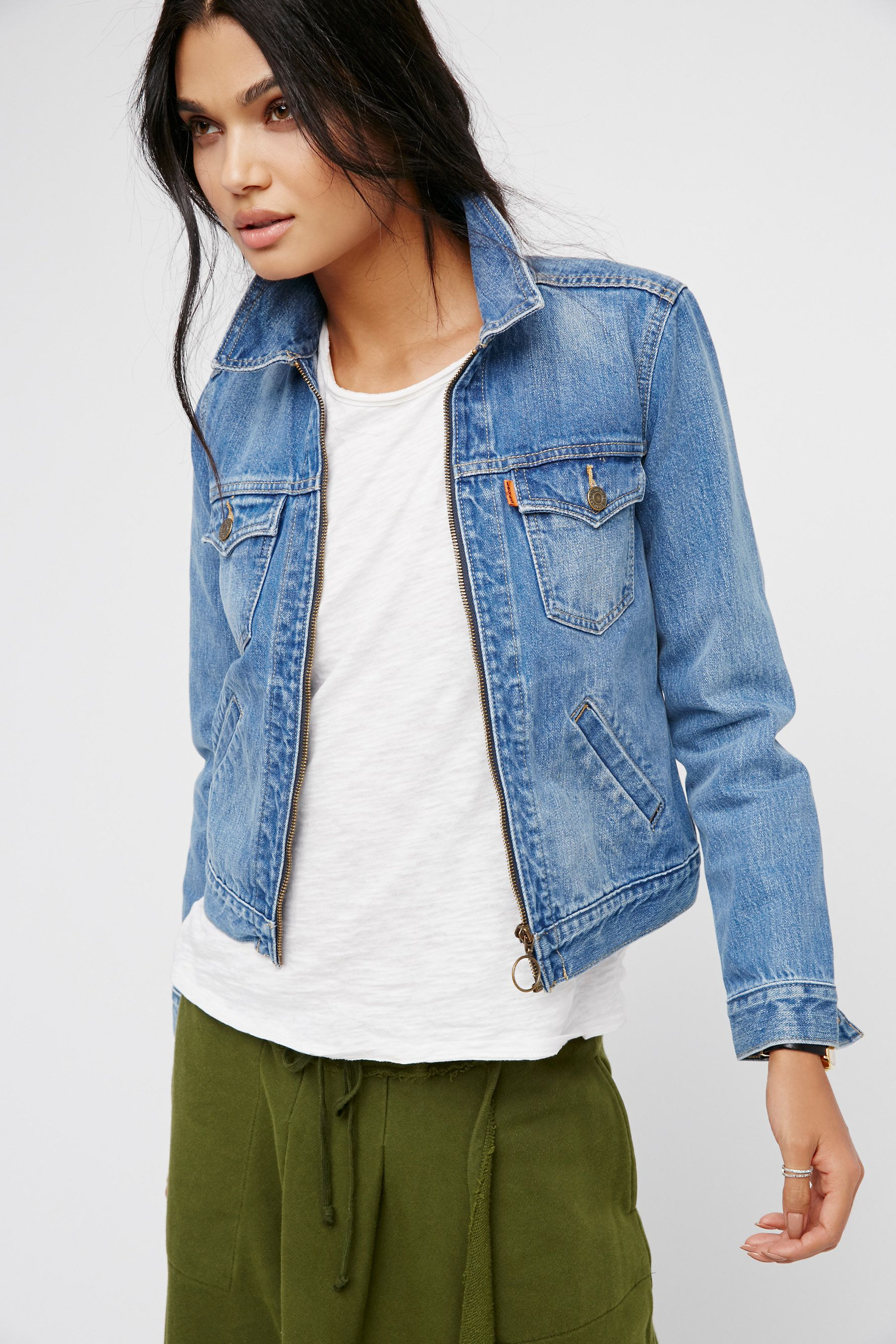 Zip Front Trucker | Retro-inspired trucker style denim jacket featuring a cute circle zipper pull. Four front pocket details.