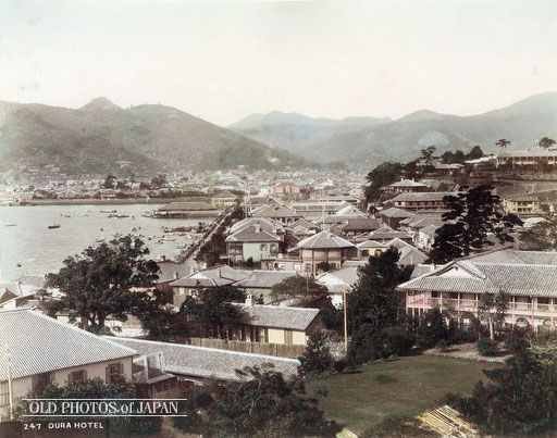 1880's, Nagasaki. Foreign Settlement. View from Minamiyamate on Nagasaki Harbor and the foreign settlement in Oura and Higashiyamate. The building with the veranda on the right is the Belle Vue Hotel, located where the ANA Hotel Nagasaki Gloverhill now stands. Opened in 1863, the Belle Vue Hotel was one of the first Western style hotels in Japan. It was mostly frequented by foreign guests.