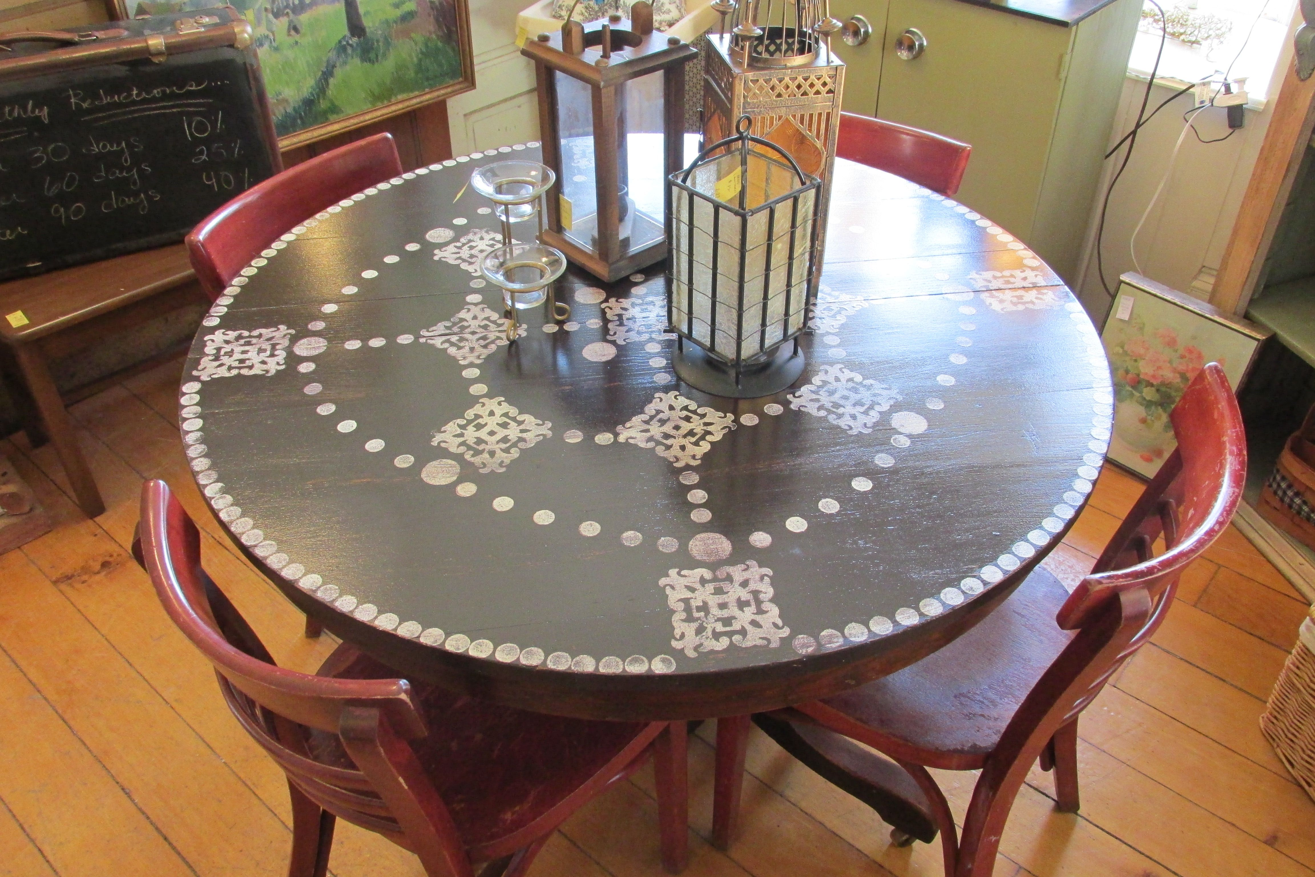 """Painted 42"""" round table W/ 4 rustic red chairs."""