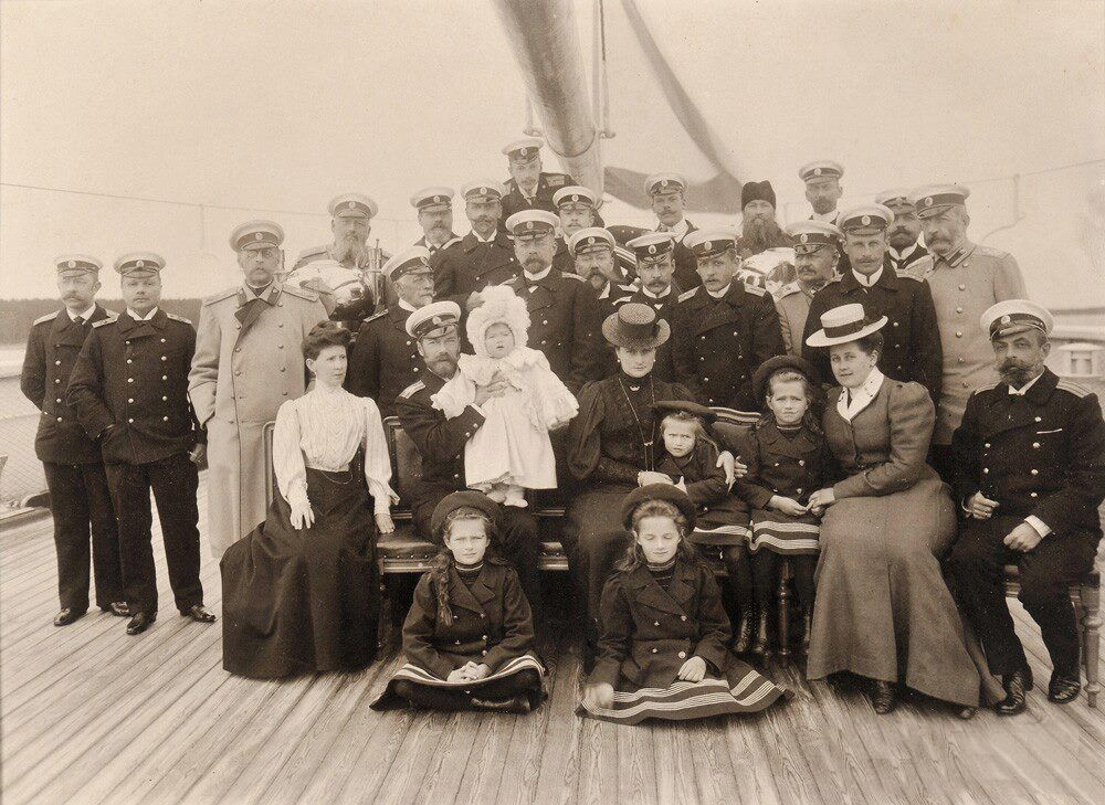 The Romanov Family (TheTsar hold infant Tsarevich Alexei, The Empress has her arm around Grand Duchess Anastasia) and the staff of the Standart