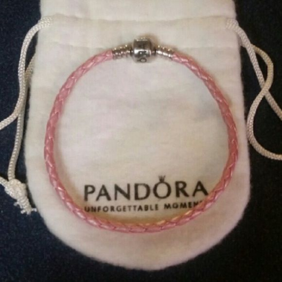 Pink pandora bracelet I'm great condition. Size 7.5 in length. Retired Pandora Jewelry Bracelets