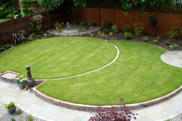 circular garden design with two overlapping round lawns and a round corner patio - Garden Design Kildare