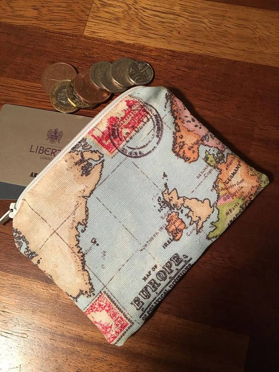 I have for sale a handmade coin pursezip pouch which ive made i have for sale a handmade coin pursezip pouch which ive made using this fab world map fabric its fully lined in a white cotton fabric this is gumiabroncs Choice Image