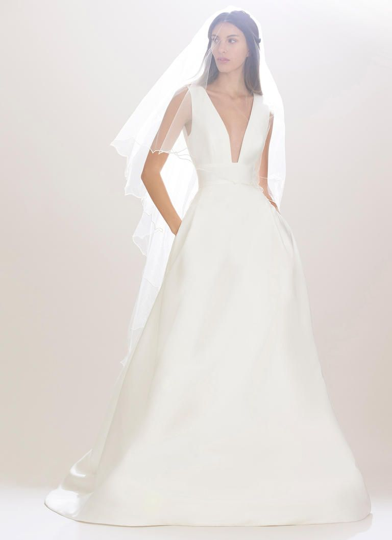 9df393dfe02 This plunge v-neck is gorgeous among the crisp satin fabric. Carolina  Herrera Bridal Fall - The Carolina Herrera Bride   The Carolina Herrera  Bride