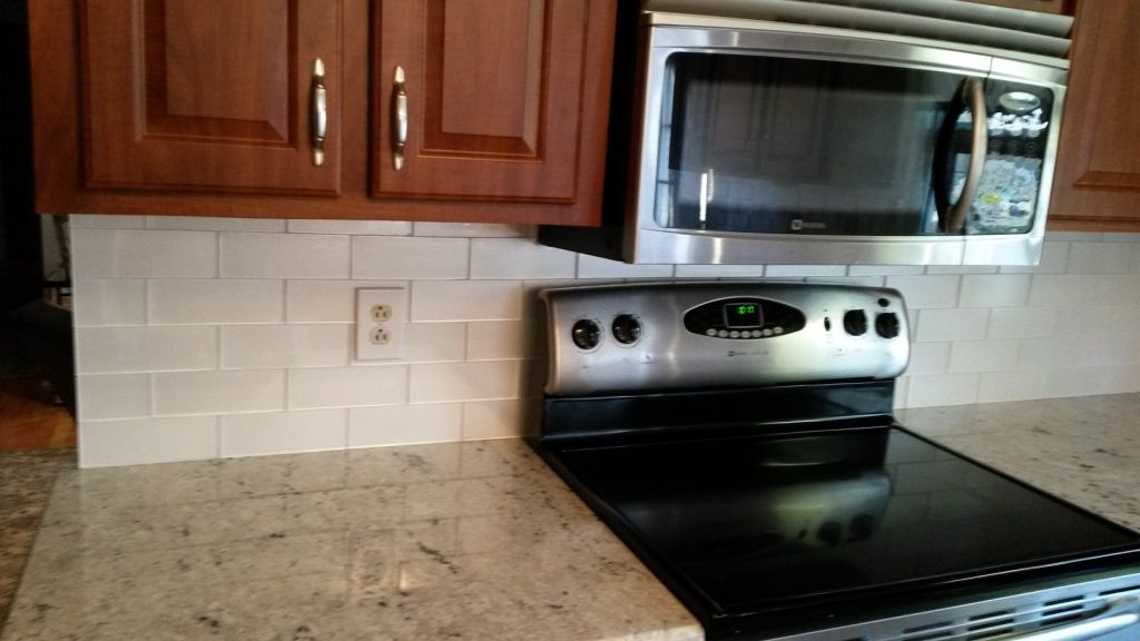 Colonial White Granite Counters With X Glass Arctic Glimmer Tile - 3x8 tile backsplash