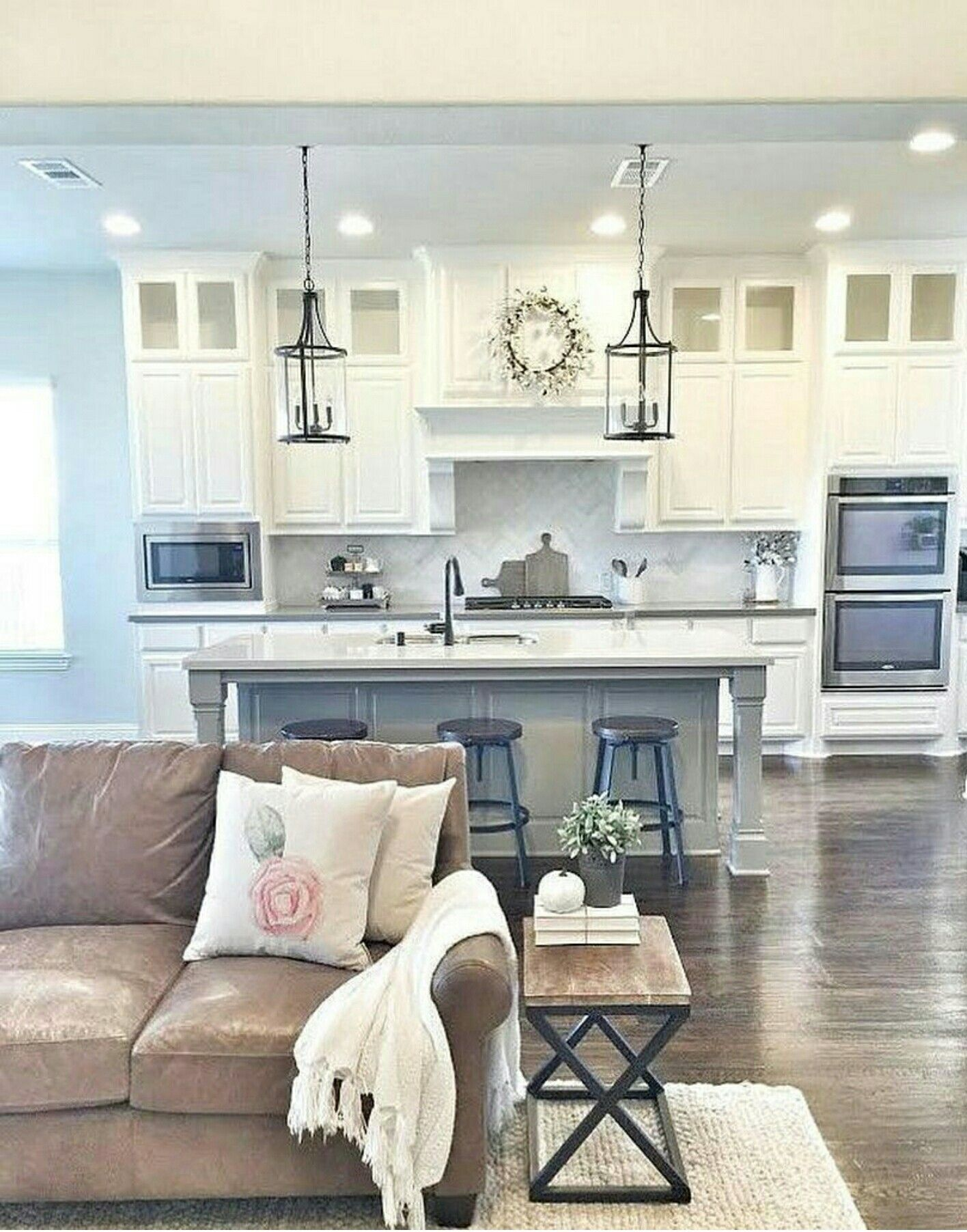 Love this color combo and open kitchen to the living area ...