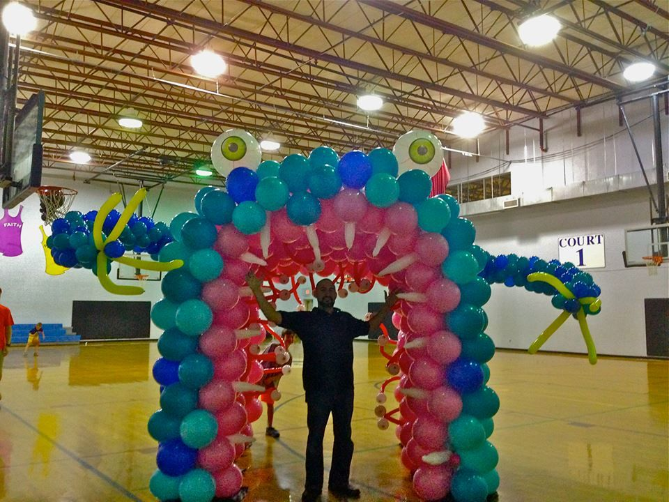 A Funny Monster Arch. Multiple Balloon arches make up the tunnel arch. So much fun!