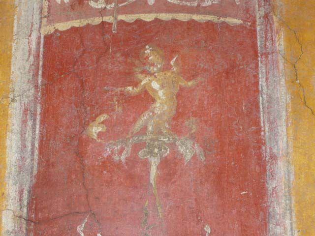 Pompeii ~ Casa degli Amorini Dorati or House of the Golden Cupids or Domus Cn. Poppaei Habiti or House of Gnaeus Poppaeus Habitus ~ Excavated 1903-5 ~ Room N, detail of cupid on candelabra on east wall, after restoration. June 2013