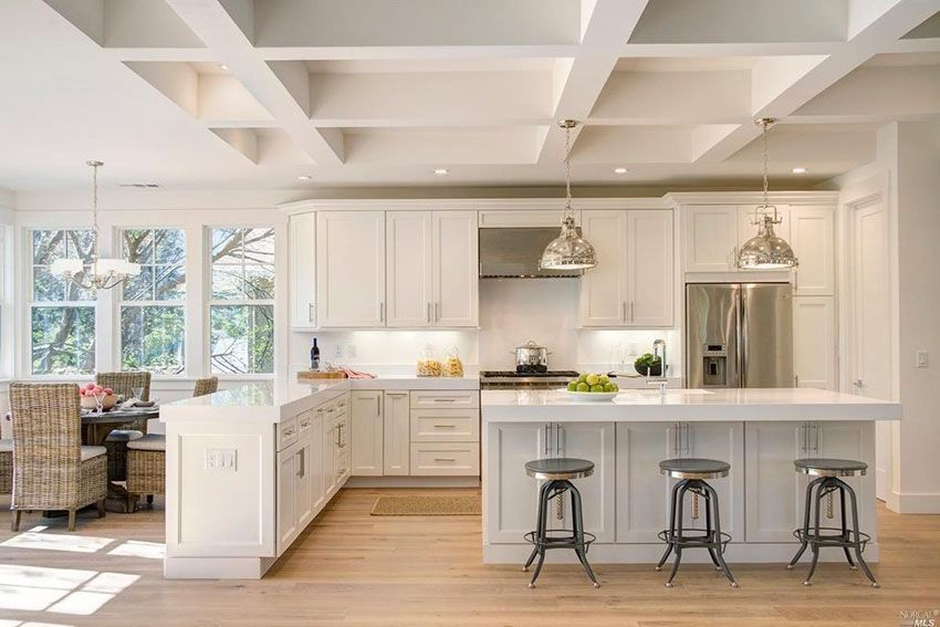 White Cabinet Transitional Kitchen With Arctic Quartz Countertops Peninsula Breakfast Bar Island And Dining