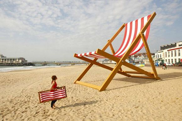 A Woman Walks Past Possibly The World S Largest Deckchair On Bournemouth Beach Giant Chair Was Built By Sculptor Stuart Murdoch Weighs Almost Six