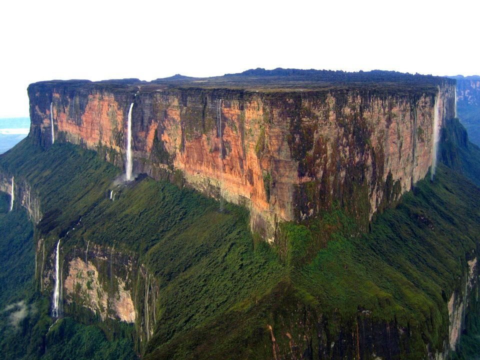 I can't find just one photo which does this place justice... can't wait to go there and take some myself. Mount Roraima in Venezuela/Brazil/Guyana is a plateau/tepui about 14km long with 400m high vertical cliffs on all sides and which rises about 1000m from the rainforest below. The top is so isolated that it's home to unique wildlife and carnivorous plants. There are big caves, massive waterfalls and crystal-filled rockpools. Who's coming?