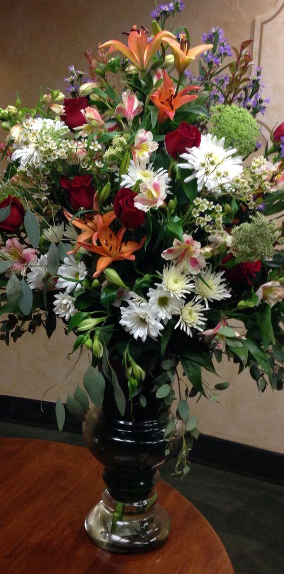 Bright floral arrangement.  www.racheljeansevents.com