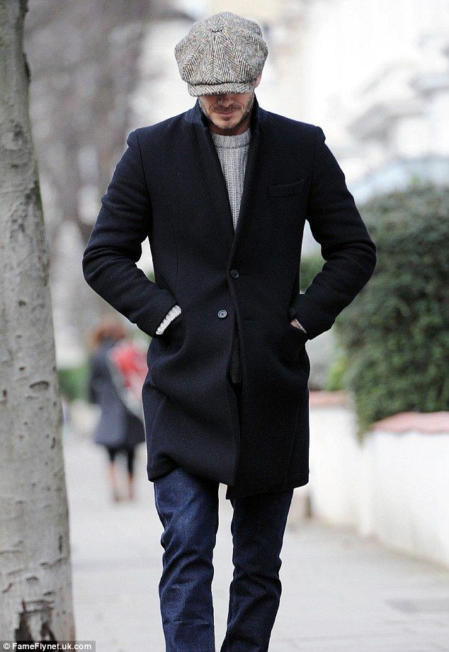 Style staple  David Beckham steps out in London on Monday morning wearing  his usual Baker Boy cap and coat ac558fbeaa95