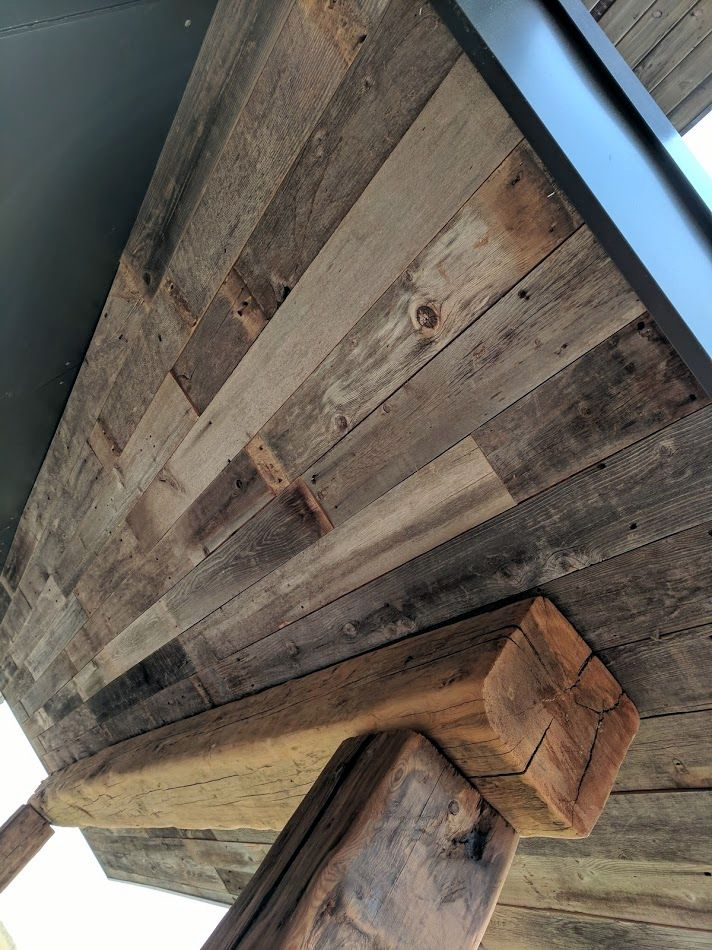 It S Hard To Beat The Look Of True Reclaimed Wood Shown Here Is Our Reclaimed Wind Fence Used As Ceiling Paneli Wood Reclaimed Wood Floors Reclaimed Wood Wall