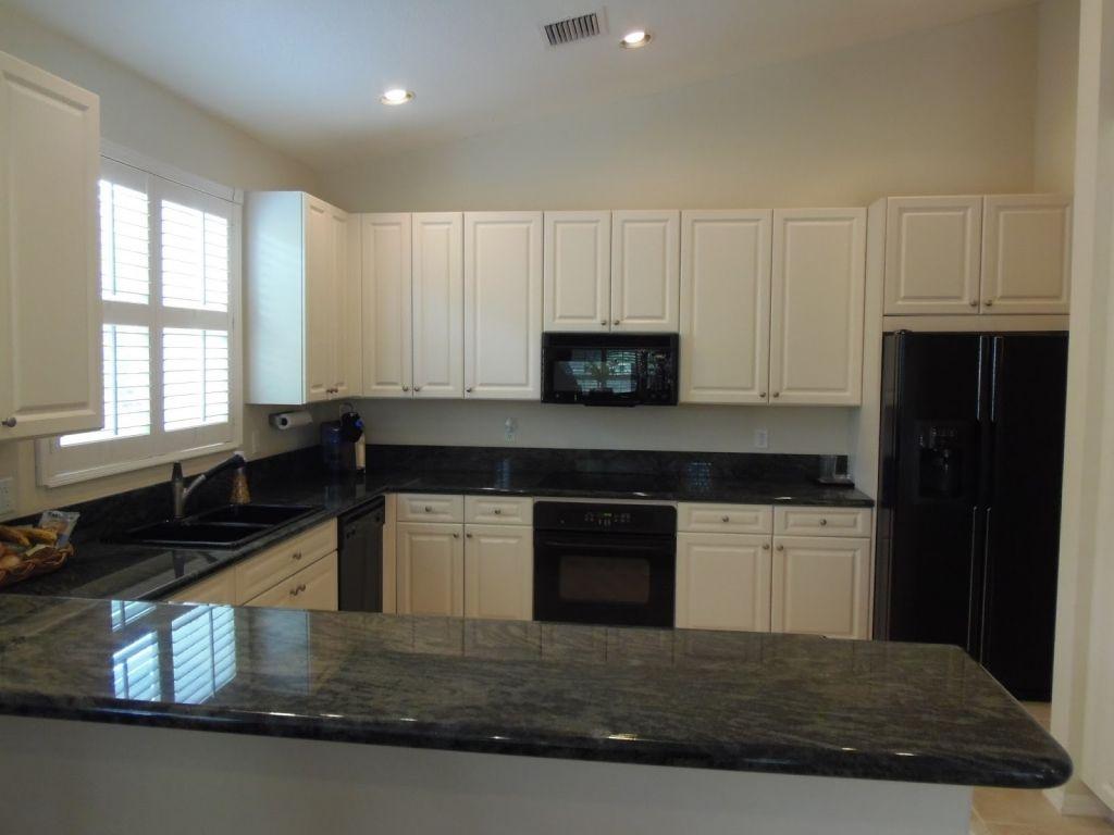 Gorgeous Modern Kitchen With Black Appliances Design White