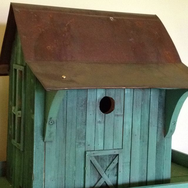 create birdhouse form scraps of salvaged blue/green boards in attic and shed