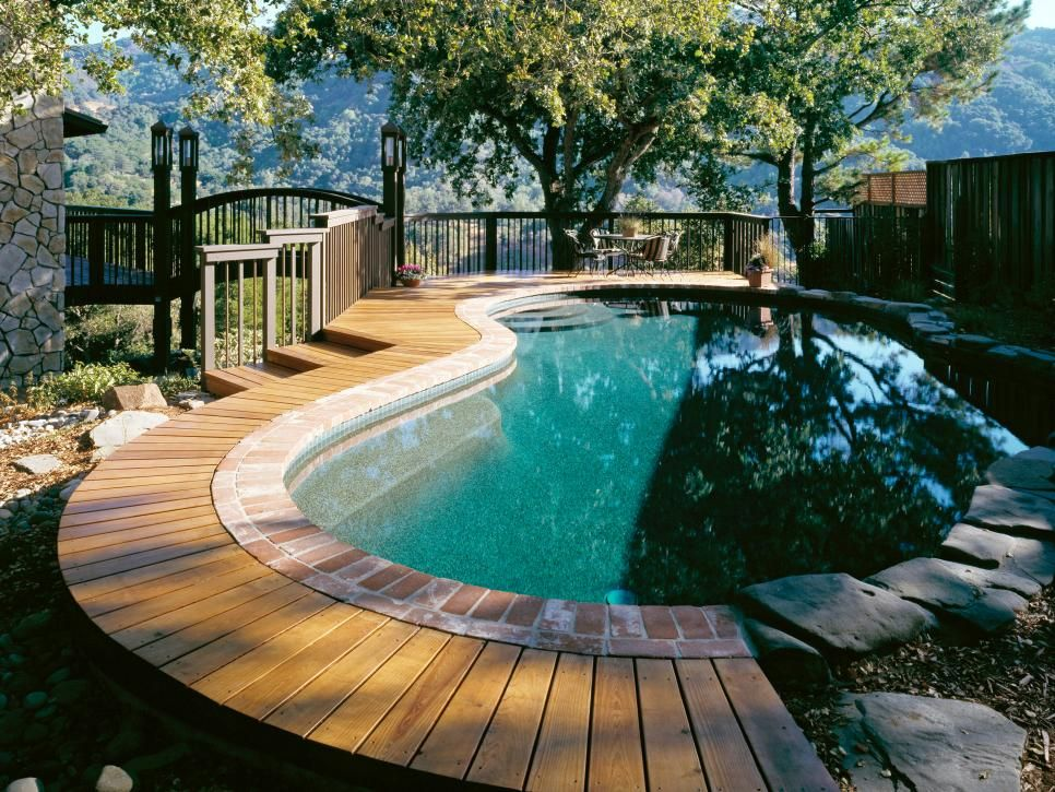 Built For Fun And Relaxation These Incredible Pools And Decks Take Outdoor Entertaining To The Next L Above Ground Pool Decks Backyard Pool Pool Patio Designs