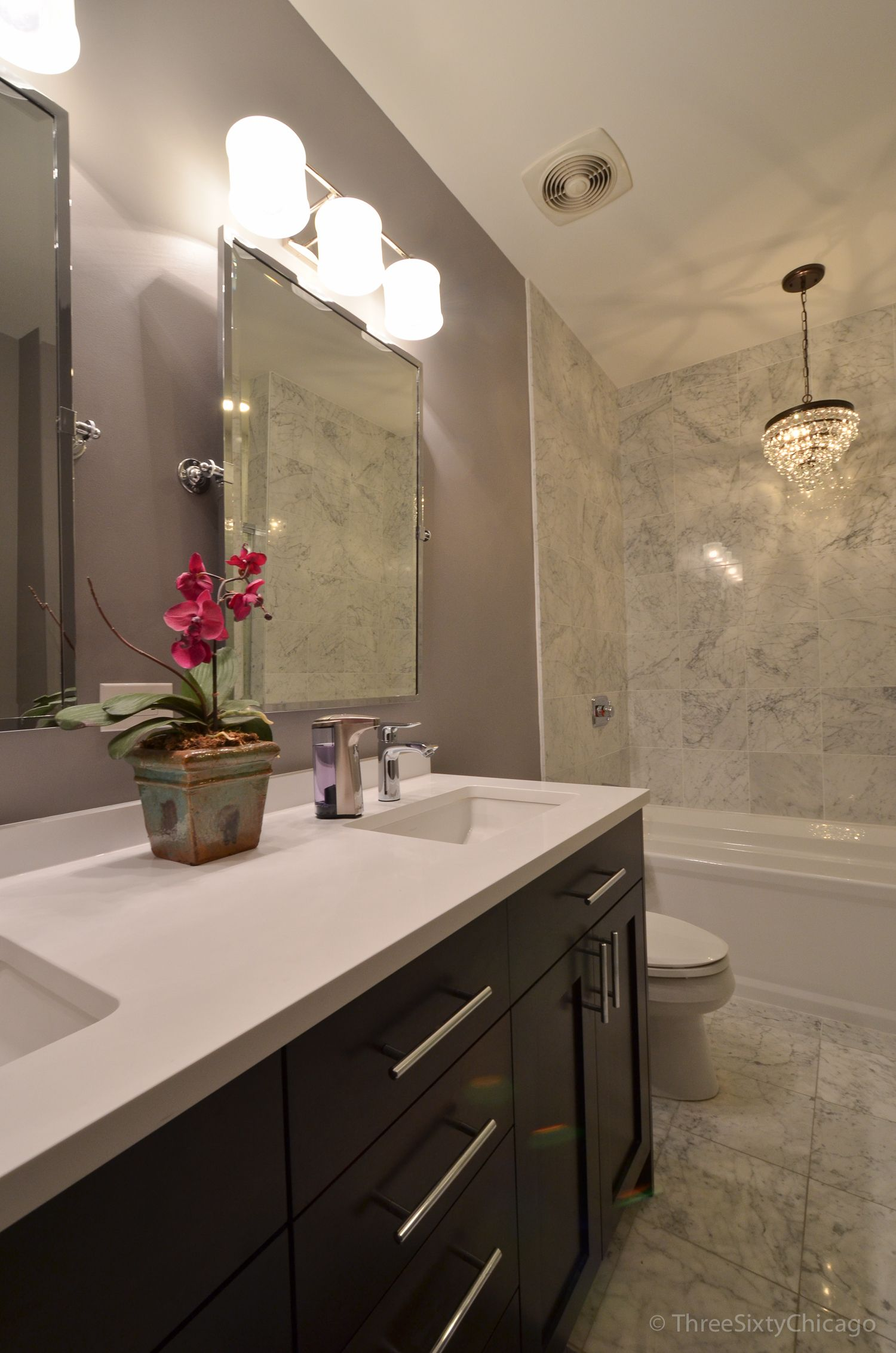 Awesome bathroom makeover in this Chicago loft. Materials are quartz ...