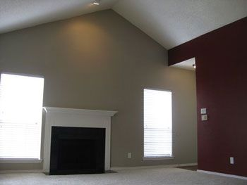 How To Decorate A Large Wall Space On A Budget Vaulted Ceiling Living Room Large Wall Space Family Room Decorating