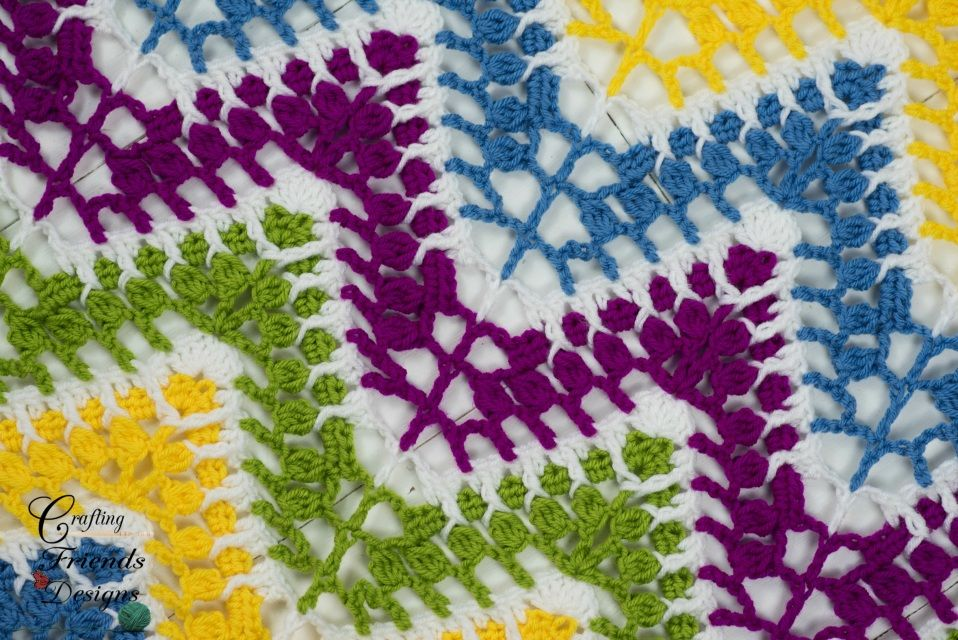Bright, cheery and fun describe the Spring Mardi Gras Chevron Afghan crochet pattern by Crafting Friends Designs best.