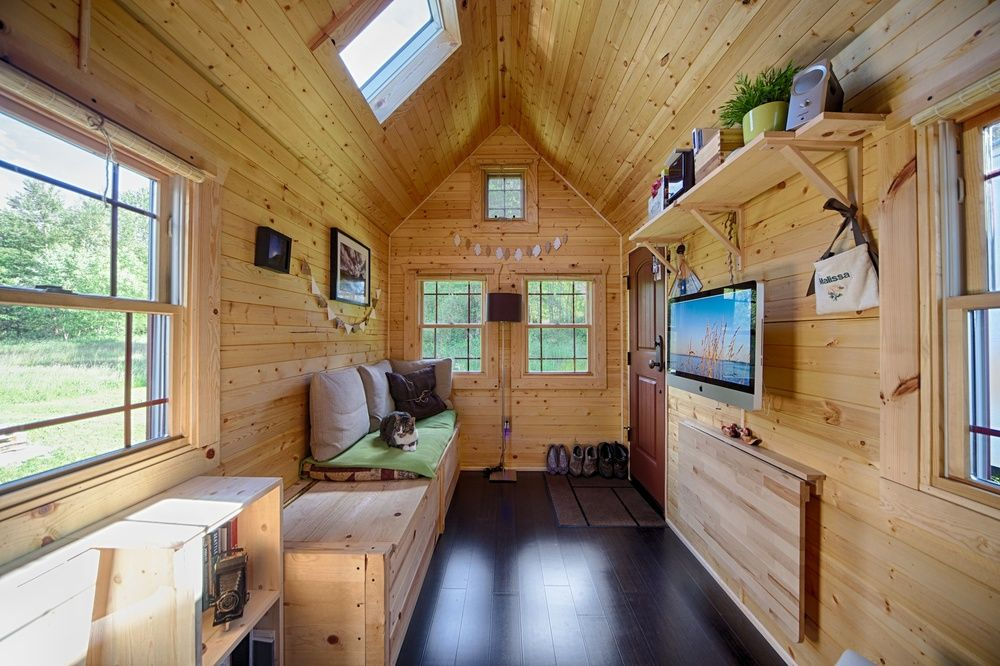 the tiny tack house imac hung from the wall fold out table right - Where Can You Build Tiny Houses