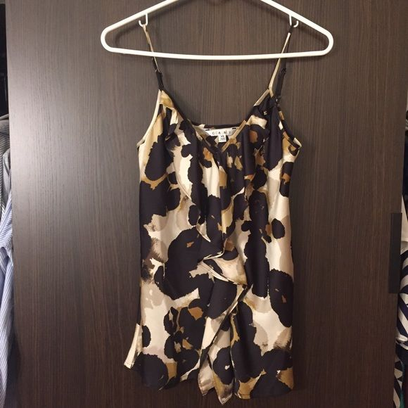 NWOT CAbi blouse Never worn - perfect to wear under a blazer or to wear to the office. Colors make it warm for fall but design keeps it relevant for spring as well CAbi Tops Blouses