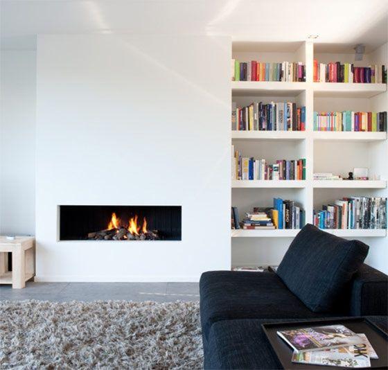 Combinatie haard boeken plaats voor persoonlijke touch for Decoratie naast tv