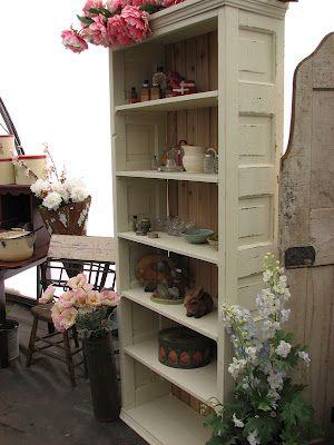 Cute Bookshelf Made Out Of An Old Door