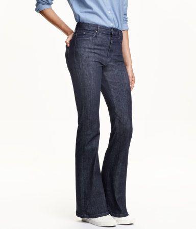 5-pocketjeans van elastisch, gewassen denim met een hoge taille en uitlopende pijpen.