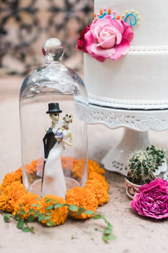 Dia De Los Muertos | Two Be Wed  Photography: Dana Fernandez / Event Design and Styling: Ashley Joseph of Two Be Wed / Floral Design: Chad Cornwall of Flower Power Productions / Paper Goods & Calligraphy: Nib & Pixel / Linens: Over the Top Linen / Chargers: A Finer Event / Table: West Elm / Vintage Chairs: Bourbon and Bloom / Dress: Damsel White Label / Hair and MUA: Hey Lovely Makeup / Cake and Cookies: Whisk Bakery / Location: Las Velas in Houston, TX