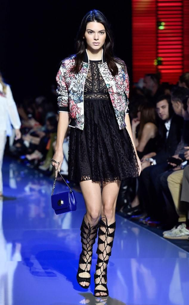 Kendall Jenner struts down the runway after flashing her