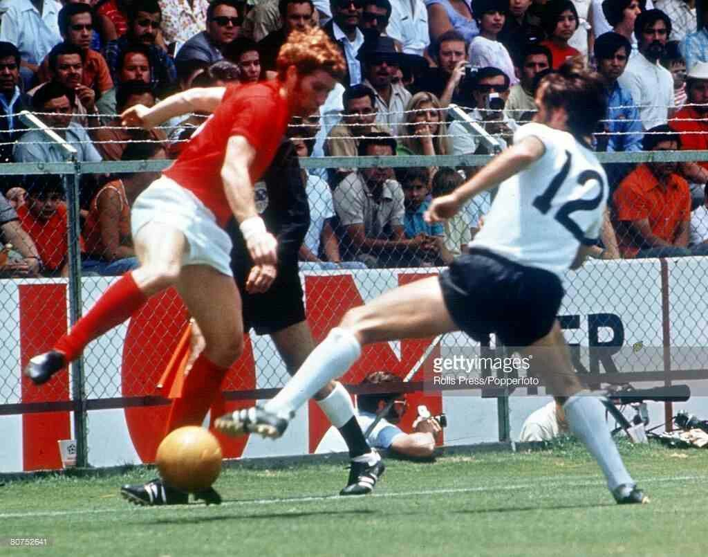 West Germany 3 England 2 in 1970 in Leon. Alan Ball takes on Wolfgang Overath in the World Cup Quarter Final.