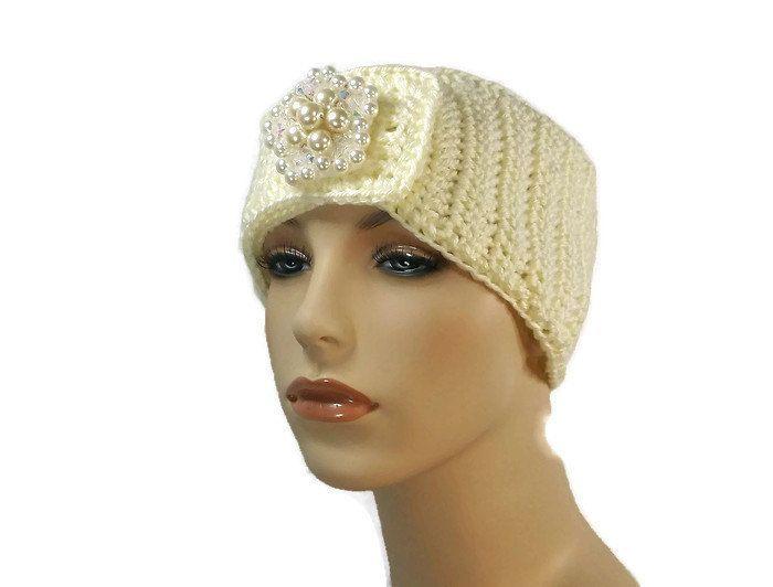 Winter white crochet ear warmer with handmade brooch,  bejeweled crochet headband, off white crochet head wrap, by KittyBritchesBoutiqu on Etsy