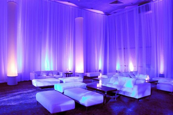 A Futuristic Sci Fi Looking Wedding Reception Lounge Featuring White Decor And Dramatic Coloured Lighting By Flutterfly Events