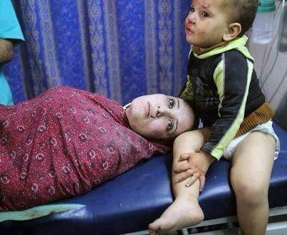 Little child did not stop crying  until he was taken to his dead mother after the israeli strike to GAZA.