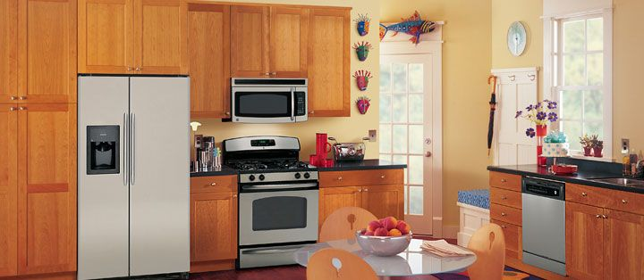 surprising yellow kitchen white appliances   Pairing cherry cabinets with stainless steel appliances is ...