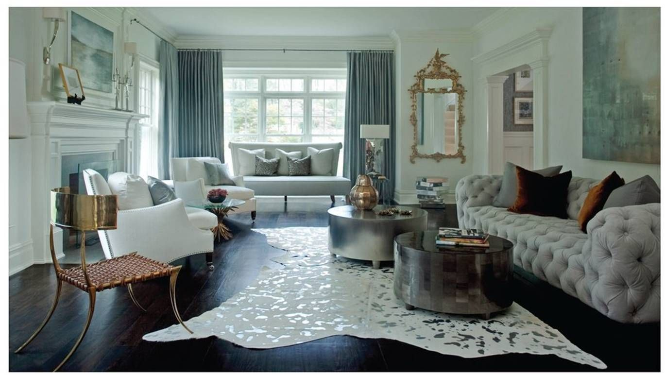 Interesting use of gold and silver.  Love the blue/green tones and artwork.  The couch and metal chair are disturbing.  :/  ~R.