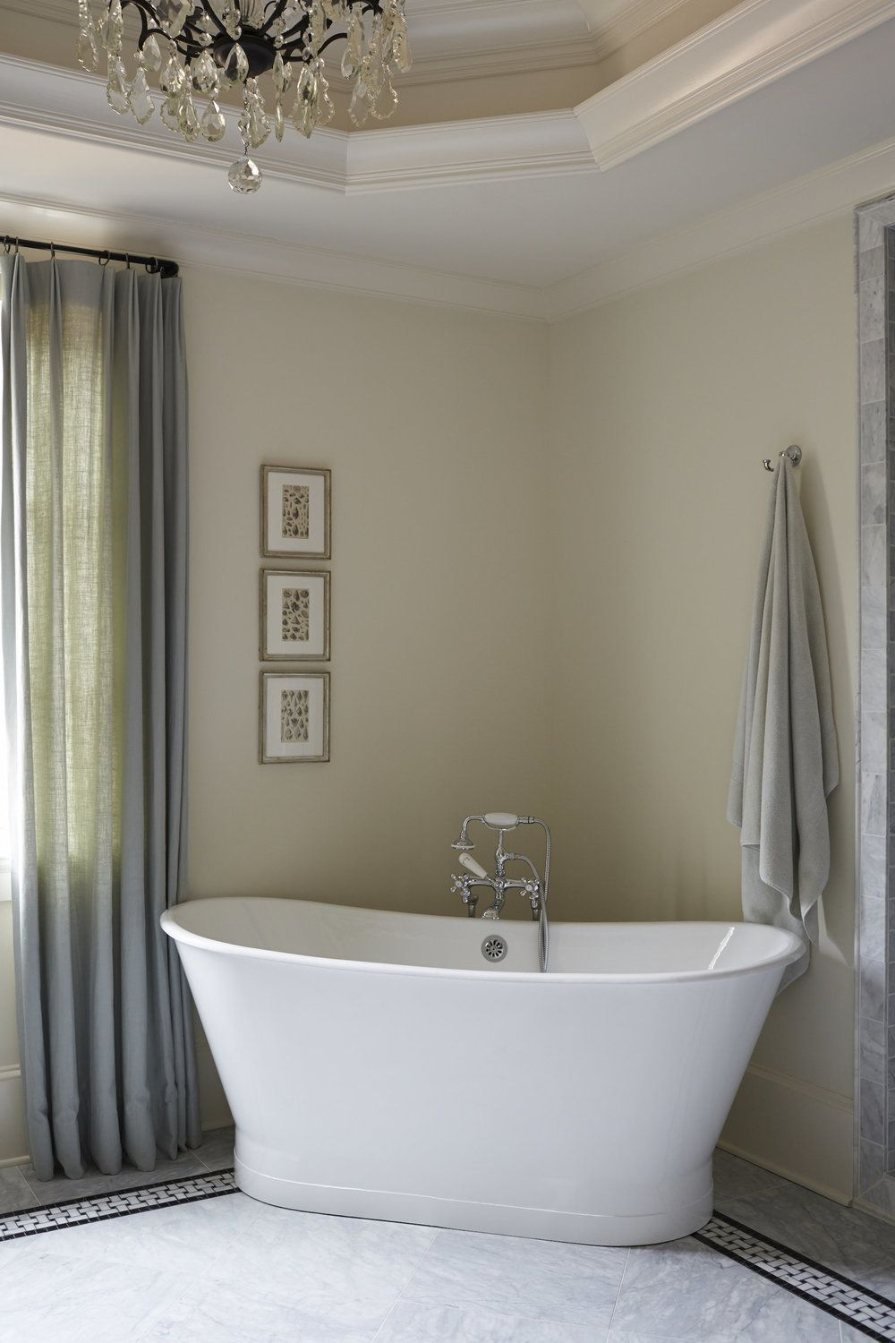 White stand alone bath tub placed in corner of bathroom | Amy Meier ...