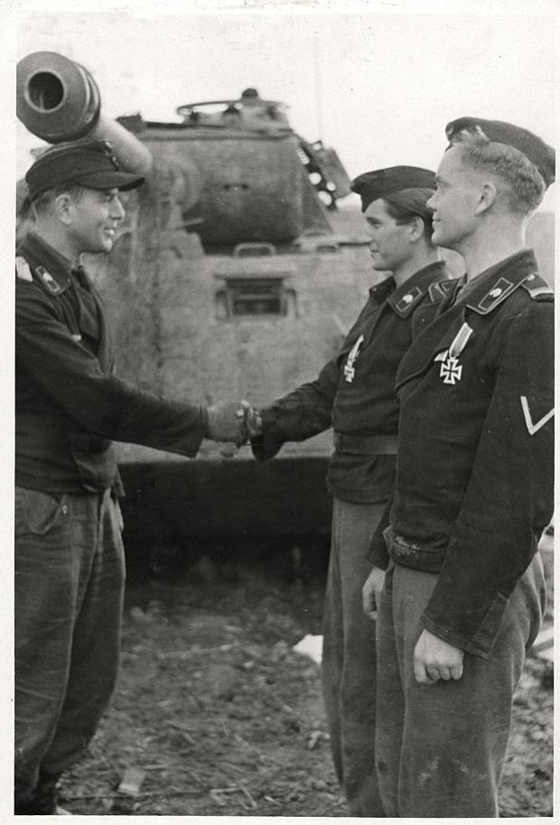 Waffen 3'rd SS Division Totenkopf , commander congratulating young Panzer corpsmen