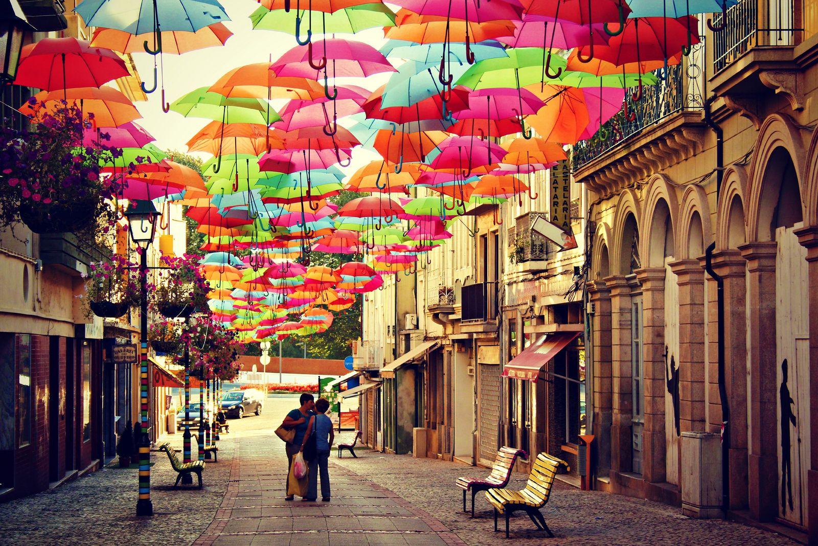 www.trippics.com | Águeda e suas ruas cobertas de guarda-chuvas coloridos em Portugal.