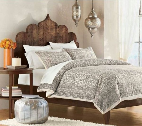 Moroccan Bedroom Ideas Lanterns Wooden Headboard Silver Pouf Side Table