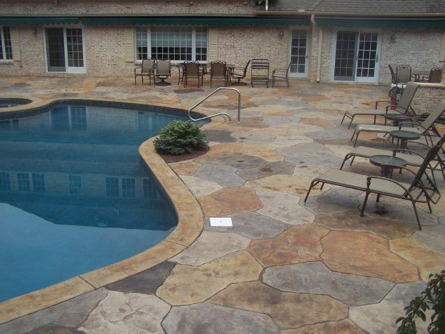 Stamped concrete patio designs multi colored stamped for Design of swimming pool concrete