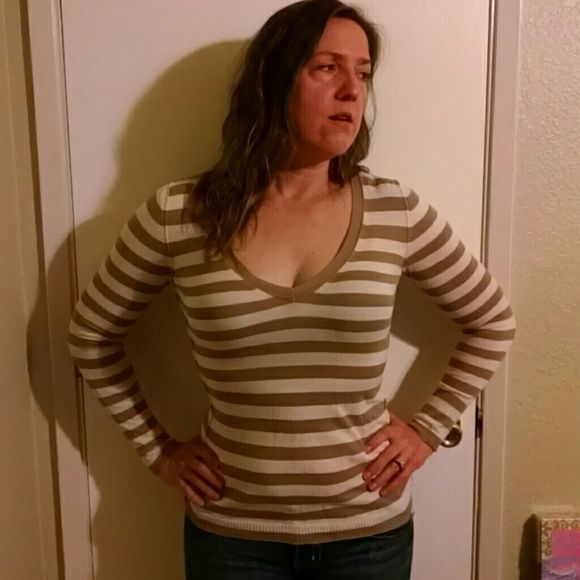 Stripped long sleeved top Beige and white long sleeved top. Deep V neckline. American Eagle Outfitters Tops