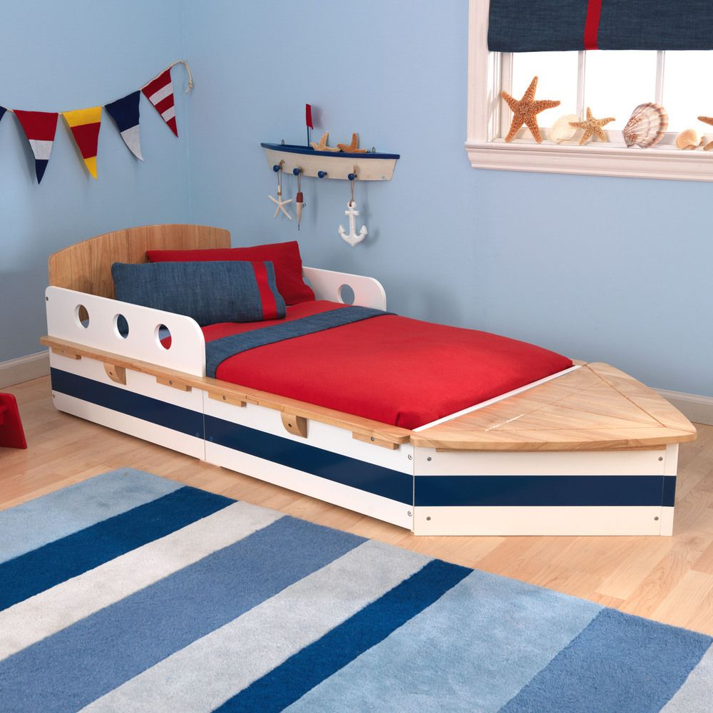 Nestle him into nautical-themed dreams when you tuck him into this boat-style bed.