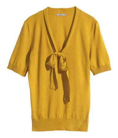 ffb7bbea Lyocell-blend Top, mustard yellow | H&M | CONSCIOUS. Fine-knit top in Tencel®  lyocell and polyamide. Gently draped neckline with a tie. Short puff  sleeves.