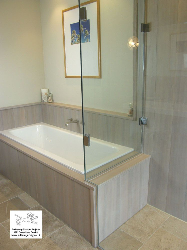 Waterproof teak tiles and boards, stained grey, around the bath and ...