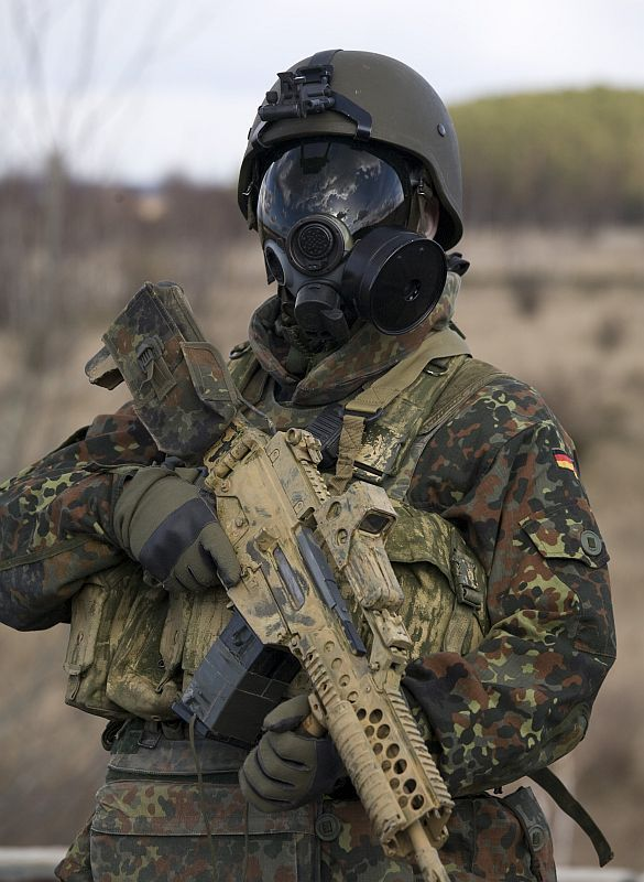 Militaryarmament Bundeswehr Soldier With A Shiny Ass Gas Mask