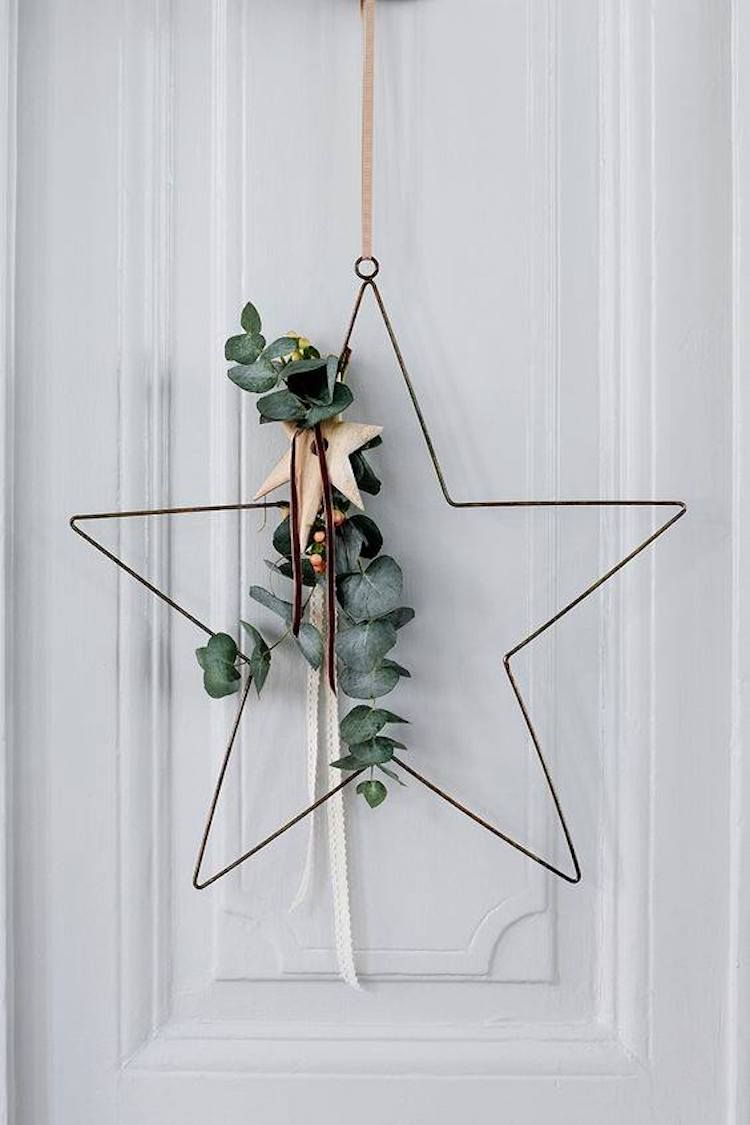 Jolie décoration de Noël en forme d'étoile pour une ambiance hygge toute en simplicité et au naturel #natural #star #hygge #simple #walldecor #decoration #christmas #nye #party #christmastime #eucalyptus