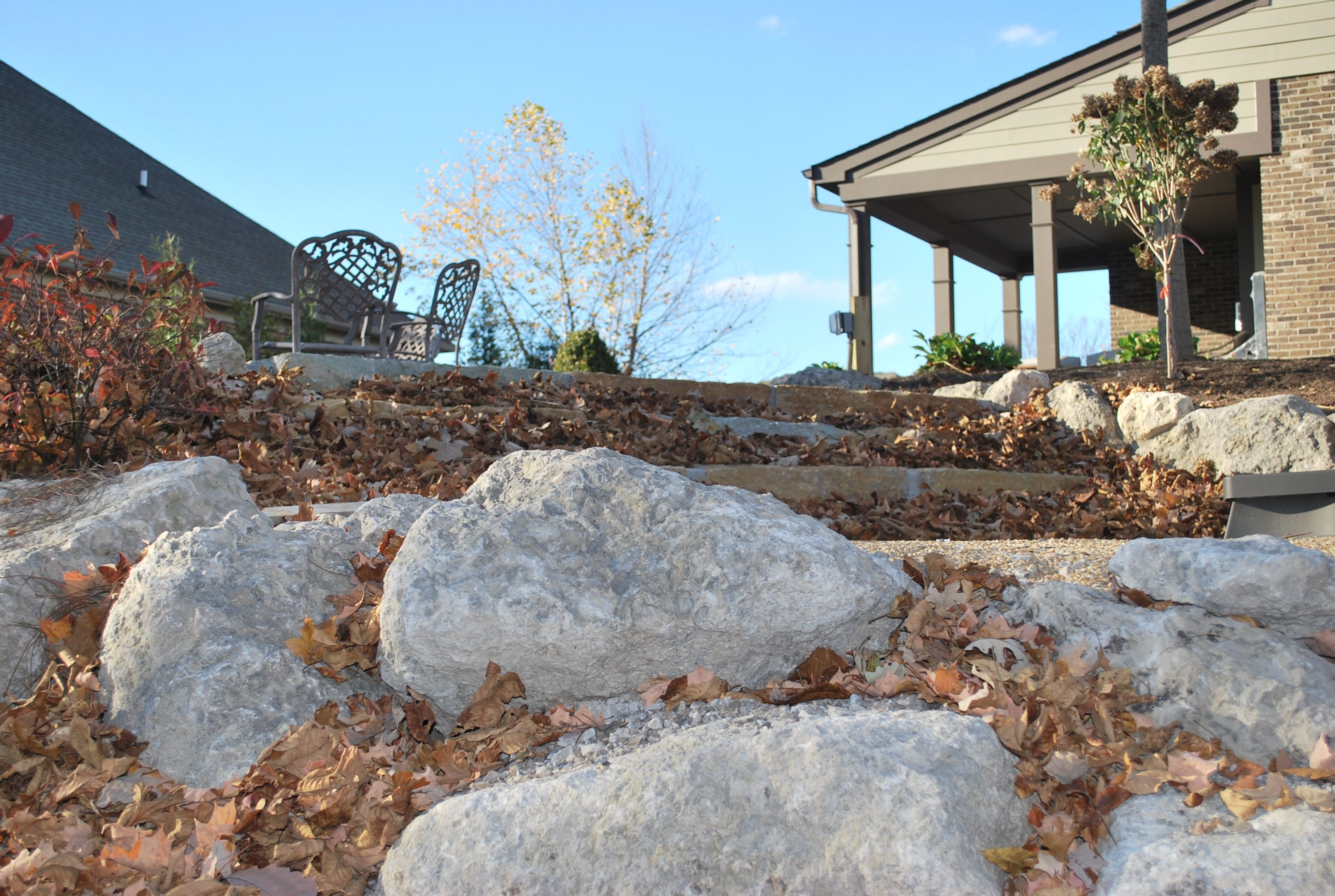 Rocks frame in your outdoor living space and add a warm ... on Rock And Stone Outdoor Living id=52305